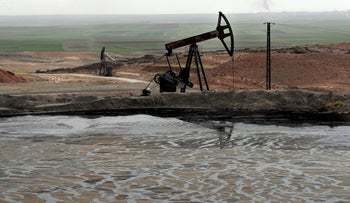 A pond of oil at an oil field controlled by a U.S-backed Kurdish group, in Rmeilan, Hassakeh province, Syria, March 27, 2018.