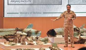 Saudi Defense Ministry spokesman Turki bin Saleh al-Malki showing pieces of what he said were Iranian cruise missiles and drones recovered from the attack on Aramco, Riyadh, September 18, 2019.
