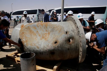 Holes caused by missile fragments in a damaged pipe at Saudi Aramco's Khurais oil field, September 20, 2019.