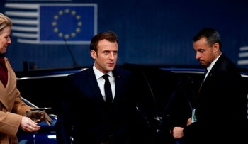 France's President Emmanuel Macron arrives for the second day of a European Union Summit at the Europa building in Brussels on December 13, 2019.