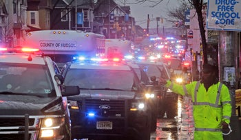 A traffic jam of police cars is seen before the funeral of Jersey City Police Detective Joseph Seals in Jersey City, N.J., Tuesday, December 17, 2019.