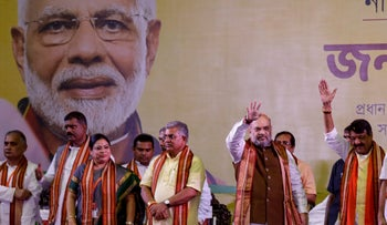 India's Home Affairs Minister and key confidante to Prime Minister Narendra Modi, Amit Shah, center, greets supporters in Kolkata, India. Oct. 1, 2019