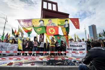 Kurdish protesters stage a rally next to the United Nations Offices in Geneva, December 17, 2019.