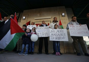 Palestinians demonstrating against the decision to end the TIPH mandate.