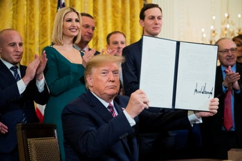 Trump shows the executive order he signed targeting what his administration says is growing anti-Semitism on U.S. college campuses in the White House, Washington D.C., December 11, 2019