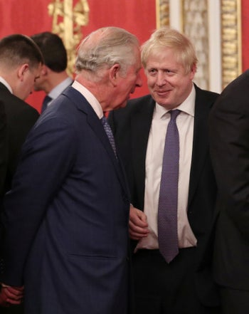 Prince Charles speaking with British Prime Minister Boris Johnson during a NATO event at Buckingham Palace in London, December 3, 2019.
