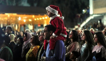 Palestinian Christians attend a Christmas tree lighting celebration on December 3, 2019 in Gaza City.