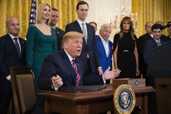 President Donald Trump gesturing before signing an executive order combating anti-Semitism, during a Hanukkah reception in the White House, December 11, 2019.