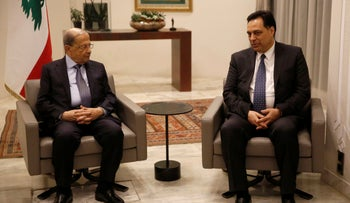 Lebanese President Michel Aoun, left, meets with Lebanese newly-assigned Prime Minister, Hassan Diab, right, at the presidential palace, in Baabda, December 19, 2019.