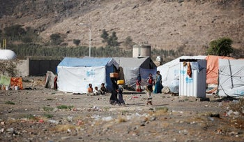 Girls carry cans they filled up with water at a camp for internally displaced people in Dharawan, near the capital Sanaa, Yemen February 28, 2017.