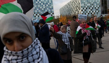 Demonstrators carry banners and Palestinian flags outside the International Criminal Court, The Hague, Netherlands, November 29, 2019.