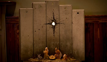 An artwork dubbed 'Scar of Bethlehem' by street artist Banksy is displayed in the Walled Off hotel, in the West Bank city of Bethlehem, December 22, 2019.