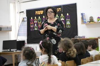 "Galit Kedem-Cohen teaching a class of preschoolers in Holon. ""When we first arrived in town, we felt like Martians. Today, we are a fact on the ground."""