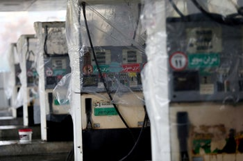 Destroyed petrol pumps are pictured at a gas station, after protests against increased fuel prices, in Tehran, Iran November 20, 2019.