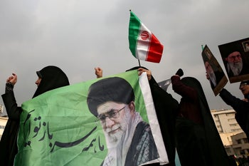 Iranian pro-government protesters attend a demonstration in Tehran, Iran November 25, 2019.