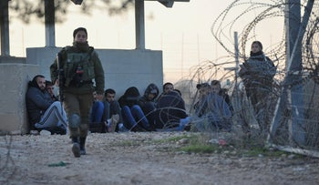 Palestinian workers arrested by Israeli soldeirs after trying to cross illegally from the village of Qaffin, Kibbutz Metzer, Israel, December 22, 2019.