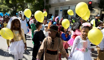Children of asylum seekers and migrants march in south Tel Aviv's Purim parade, March 19, 2019.