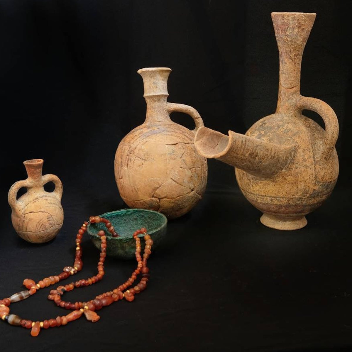 Cypriot and Phoenician pottery with metal bowl and beads found with three bodies in the Phoenician grave at Achziv