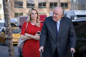 "Charlize Theron, left, and John Lithgow in a scene from ""Bombshell."""