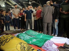 Mourners prepare for prayers over the bodies of Rafat Ayyad and his two sons, who were killed in an Israeli airstrike, during their funeral at a mosque in Gaza City, November 13, 2019.