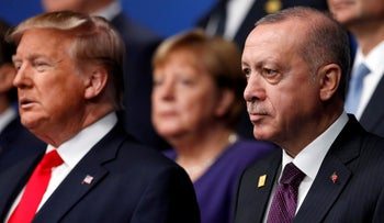 U.S. President Donald Trump and Turkey's President Tayyip Erdogan pose for a family photo during the annual NATO heads of government summit at the Grove Hotel in Watford, Britain December 4, 2019.