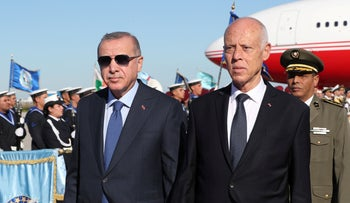 Turkish President Recep Tayyip Erdogan and Tunisian President Kais Saied at the airport in Tunis, December 25, 2019