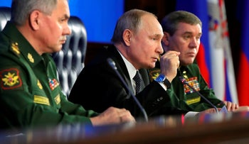 Vladimir Putin speaks during an annual meeting with top military officials in Moscow, Dec. 24, 2019.