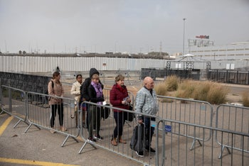 People waiting in line at the entrance to the Immigration Authority offices in Bnei Brak on December 25, 2019.
