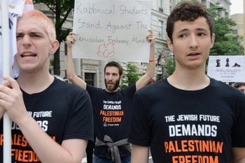 Members of IfNotNow and Rabbinical school students blocking traffic while protesting Trump's US Embassy move to Jerusalem, withdrawal from Iran Deal and Israeli violence against Palestinians in Gaza in Washington, D.C. on  May 14, 2018