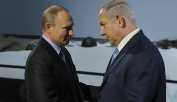 Vladimir Putin and Benjamin Netanyahu shake hands at an event at the Jewish Museum and Tolerance Center in Moscow, Russia, January 29, 2018.