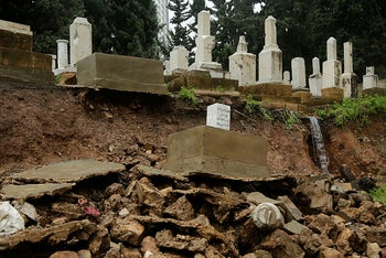 Graves from a Jewish cemetery lie on a sidewalk after it collapsed following heavy rains in the Sodeco area of Beirut, Lebanon, December 26, 2019.