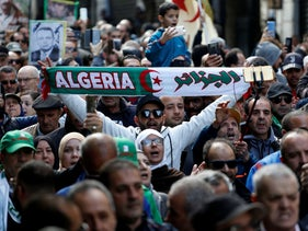 Protesters take to the streets in the capital Algiers to reject the presidential elections and protest against the government, in Algeria, December 27, 2019.