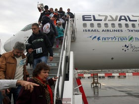 Jewish new immigrants from Ukraine, walk down the stairs as their airplane lands at Ben Gurion International airport on December 22, 2014.