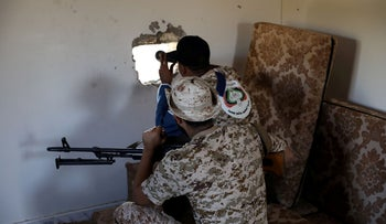 Members of the Libyan internationally recognised government forces take their positions in Ain Zara, Tripoli, Libya October 14, 2019.