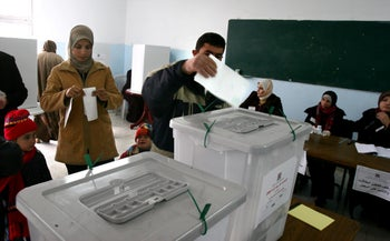 Palestinians cast their vote at a polling station in the West Bank Village of Azaria Wednesday Jan 25 2006.