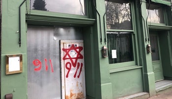 '9.11' sprayed alongside a Star of David in Hampstead, north London, implying Jews were involved in the September 9 attacks.