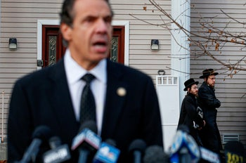 New York Governor Andrew Cuomo speaks to the media outside the home of rabbi Chaim Rottenbergin Monsey, in New York on December 29, 2019.