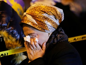 Orthodox Jewish women mourn during the funeral service of Mindel Ferencz who was killed in a kosher market that was the site of a gun battle in Jersey City, N.J.