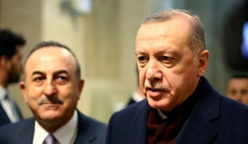 Turkey's President Recep Tayyip Erdogan speaks to media next to Foreign Minister Mevlut Cavusoglu after the Global Refugee Forum at the United Nations in Geneva, Switzerland, December 17, 2019,