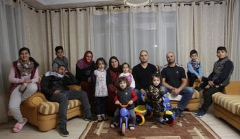 The Sumreen family pose for a photo in their East Jerusalem home, March 23, 2018.