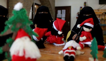 Palestinian women make Santa-themed Christmas toys in the northern Gaza Strip December 29, 2019.