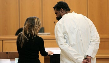 Grafton Thomas, right, appears for his arraignment at Ramapo Town Hall in Ramapo, N.Y., on December 29, 2019.