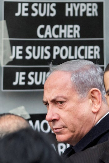 Prime Minister Benjamin Netanyahu arriving at the Hyper Cacher kosher supermarket in Paris, three days after four French Jews were murdered there on January 9, 2015.