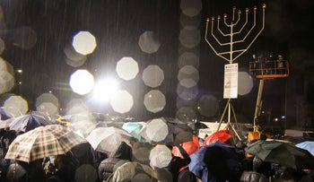 People gather at Grand Army Plaza in solidarity with the victims after an assailant stabbed five people attending a party at an Hasidic rabbi's home in Monsey, N.Y., on December 28, 2019,