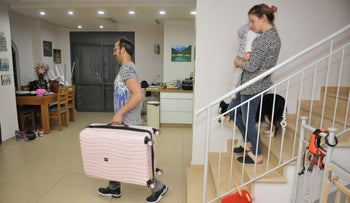 The Kopf family of Zichron Yaakov prepares to leave their home.