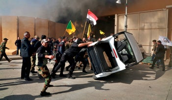Protesters damage property inside the U.S. embassy compound, in Baghdad, Iraq, Dec 31, 2019.