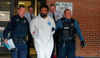 Suspect Thomas Grafton leaving Ramapo Town Hall in Airmont, New York, after being arrested on December 29, 2019.