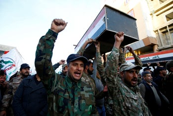 Hashd al-Shaabi  fighters carry coffins of members of the Kataib Hezbollah militia group, in Najaf, Iraq, December 31, 2019.