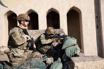 U.S. Army soldiers from 1st Brigade, 25th Infantry Division, Task Force-Iraq, manning a defensive position at Forward Operating Base Union III in Baghdad, Iraq, December 31, 2019.