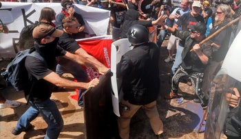 White nationalist demonstrators clashing with counterprotesters in Charlottesville, Virginia, August 12, 2017.